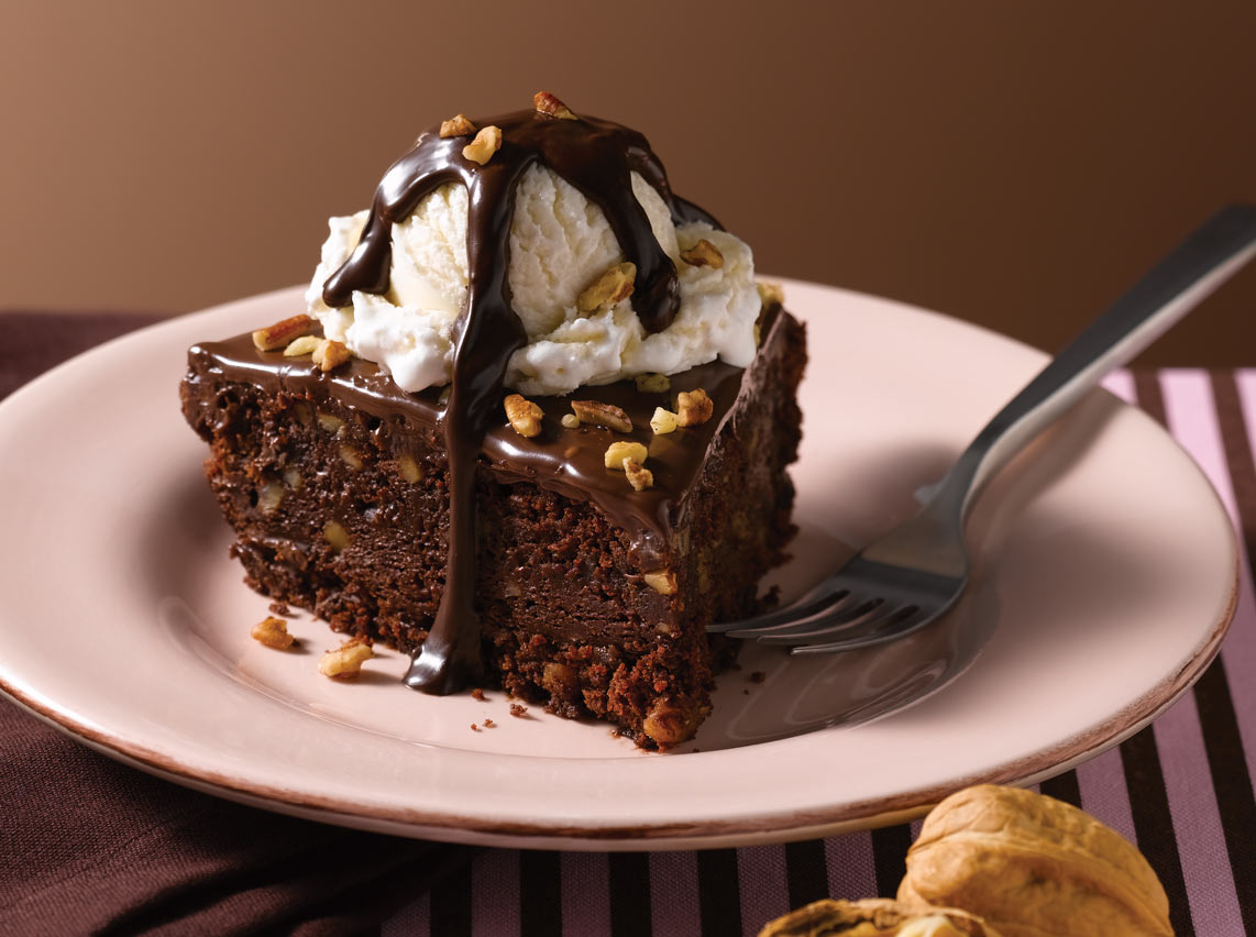 slice of our rich, triple-chocolate brownie pie baked with walnuts ...